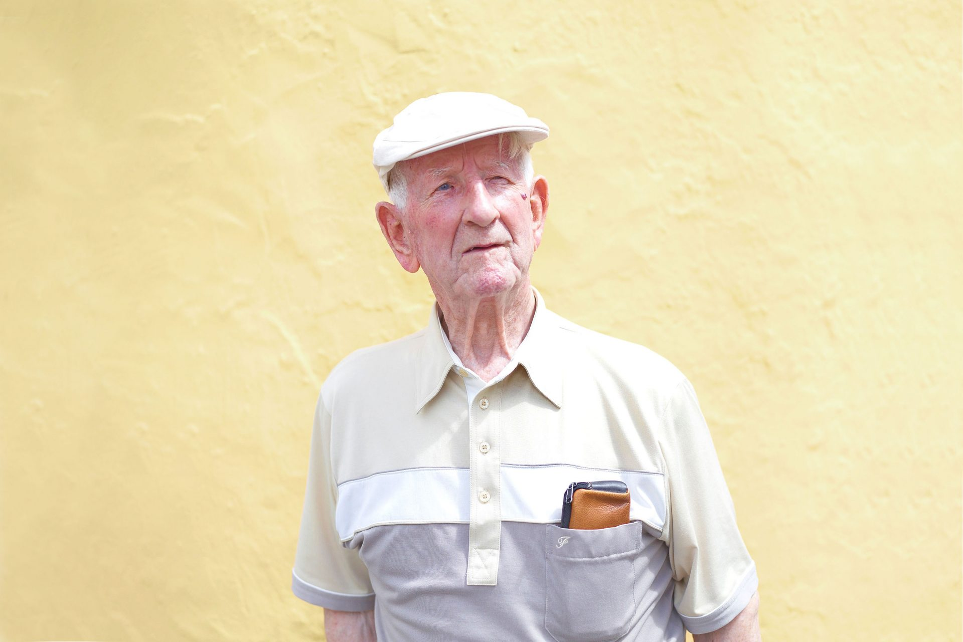 old man with a  wallet in his breast pocket yellow wall day tripper – Shaw and Shaw Advertising photographers Manchester photographer – Shaw & Shaw Photography
