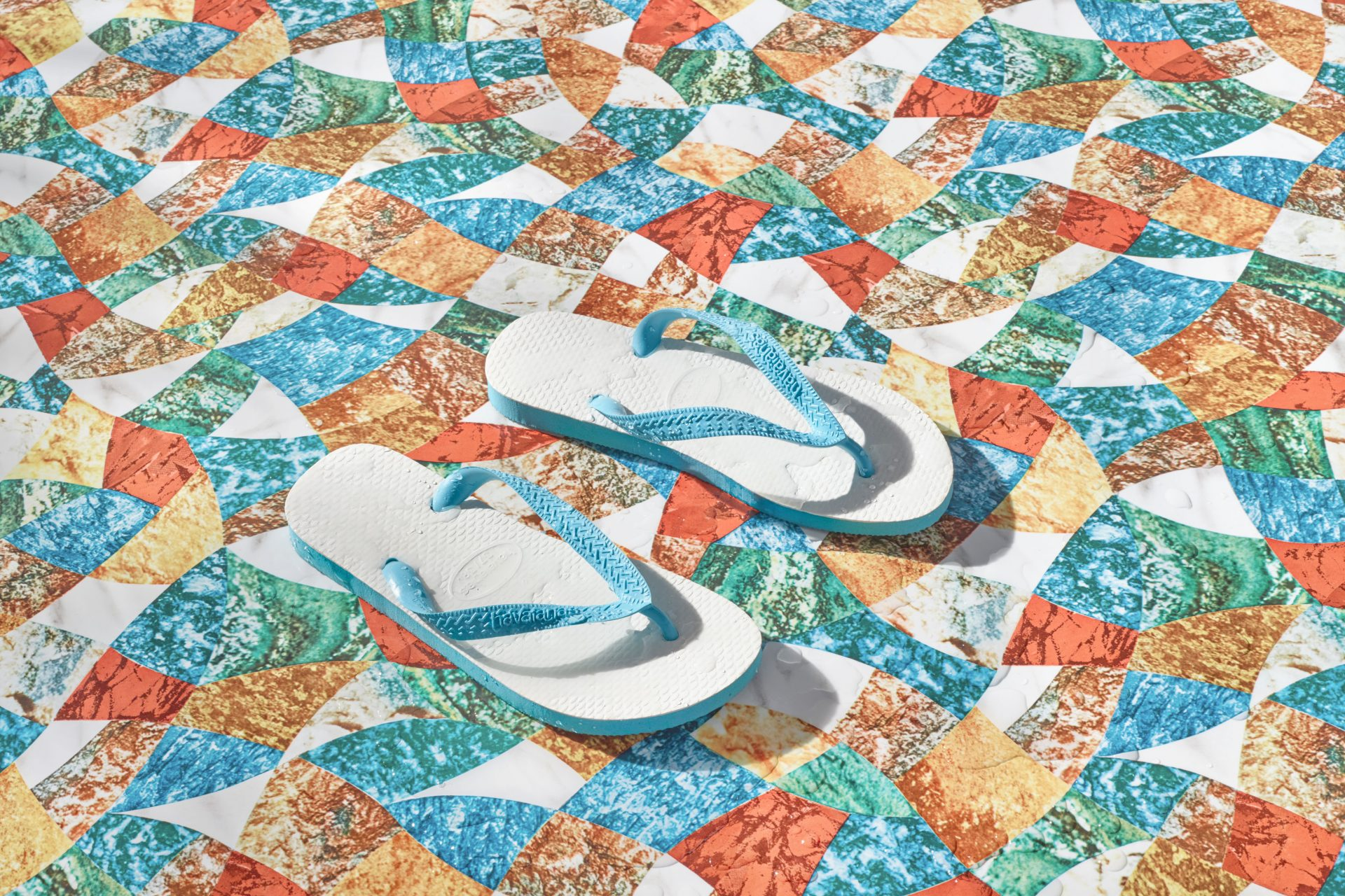 Shaw & Shaw Flip Flops on a patterned floor in the sun – Shaw and Shaw Advertising photographers Manchester photographer – Shaw & Shaw Photography