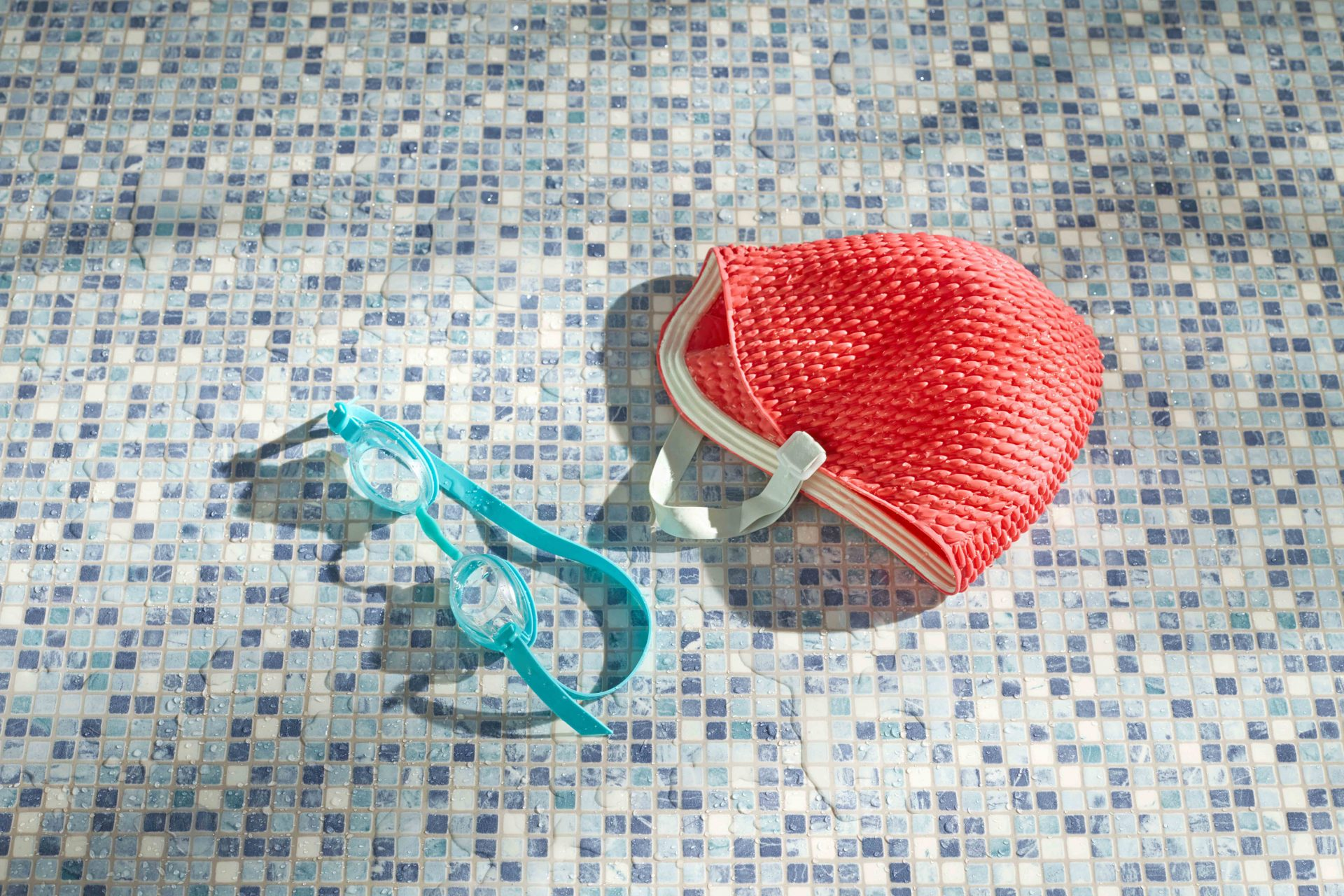 Shaw & Shaw – Swimming Cap and goggles in dappled light patterned lino – Shaw and Shaw Advertising photographers Manchester photographer – Shaw & Shaw Photography