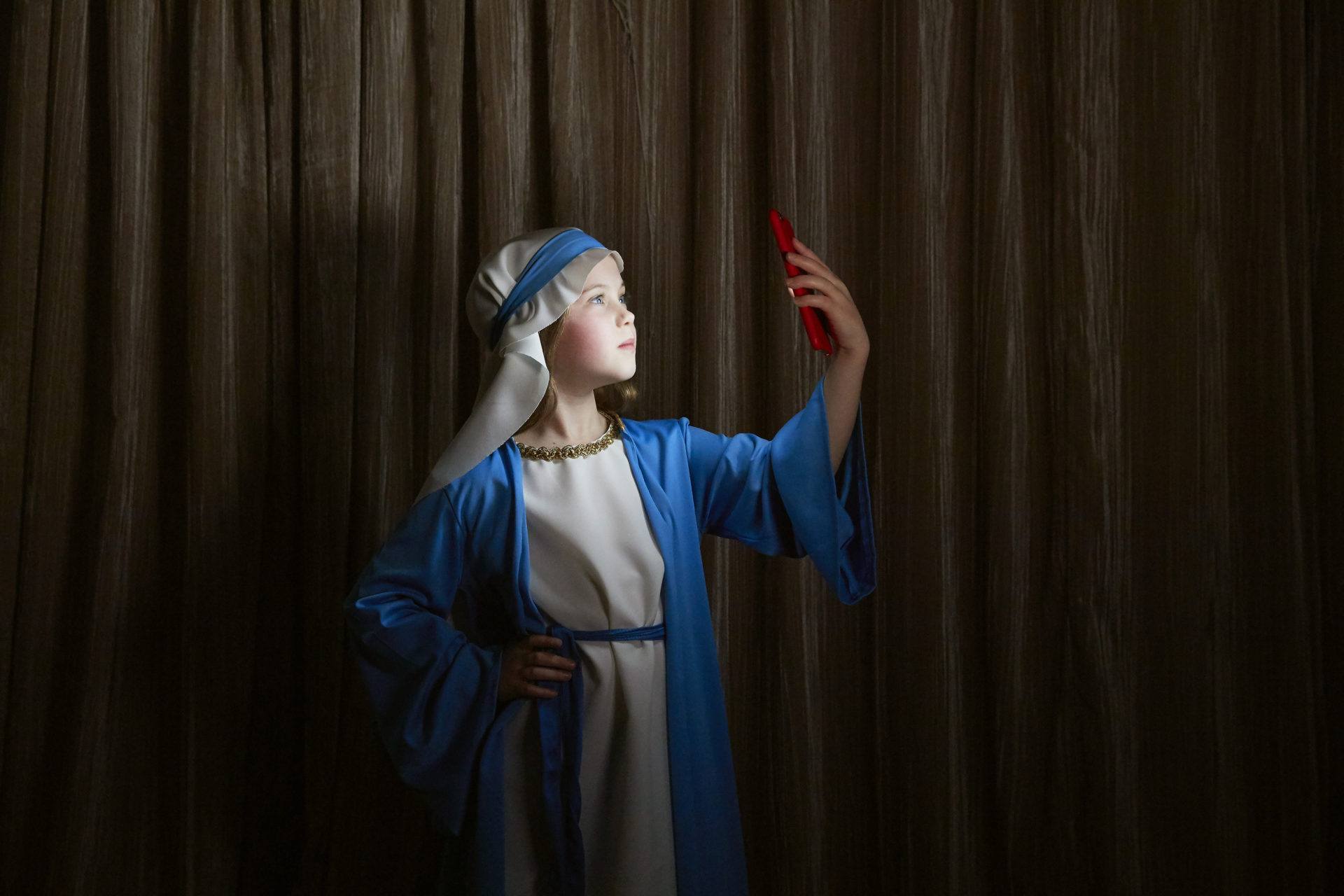 Shaw & Shaw Photography – Shaw and Shaw Photographers Manchester – advertising photographers – graphic image – Mary – Our Lady – girl taking selfie with iPhone dressed as Mary – Christmas play – Nativity play