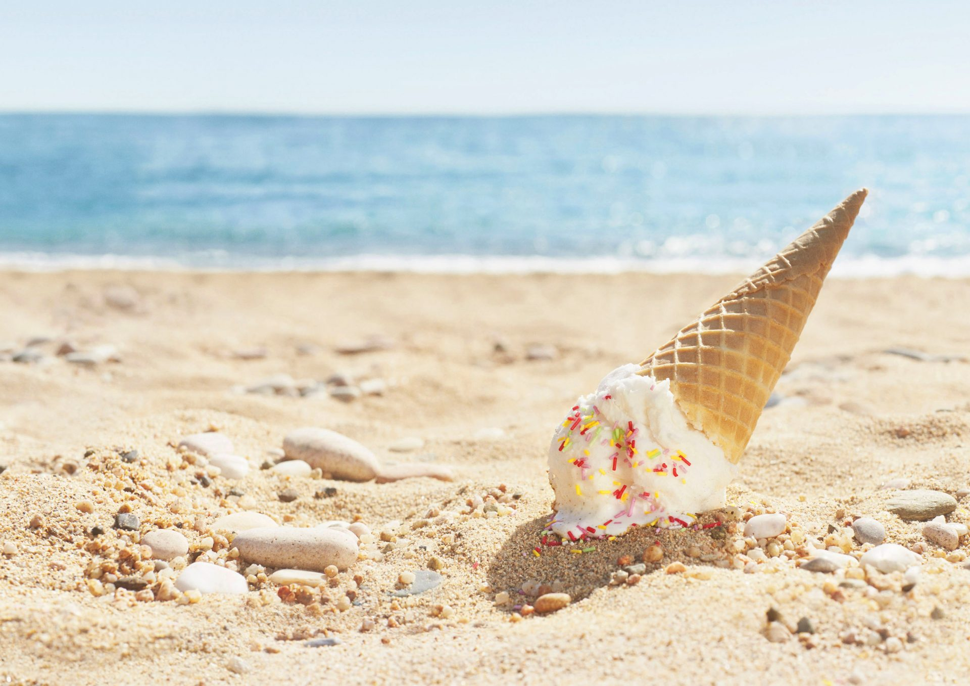 JWT London Shaw & Shaw – Canon camera – canon international – dropped Ice Cream on the beach oops! – hundreds and thousands – Shaw and Shaw Advertising photographers photographer photography