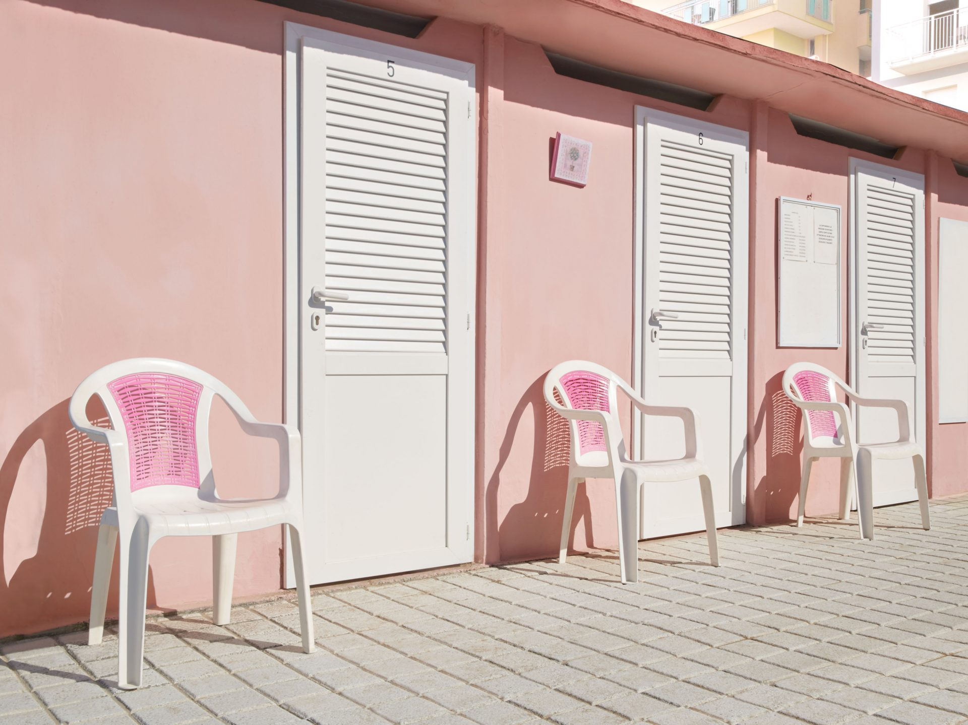 Shaw & Shaw -pink plastic chairs pink wall – Shaw and Shaw Advertising photographers photographer photography