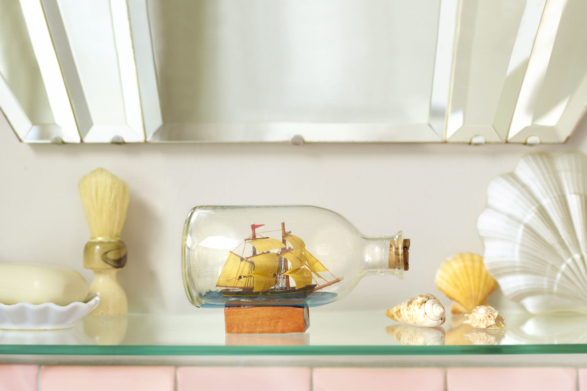 Ship in a bottle on a bathroom shelf – Shaw & Shaw Photography campaign – Shaw and Shaw advertising photographers