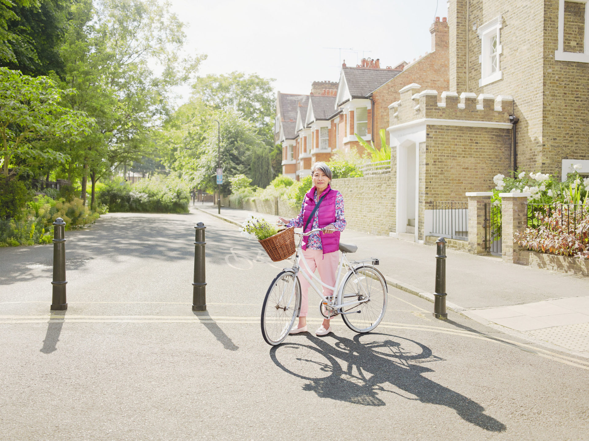 M&C Saatchi – Transport for London quietways – woman on a white bike wearing pink gilet – Shaw & Shaw Photography campaign – Shaw and Shaw advertising photographers
